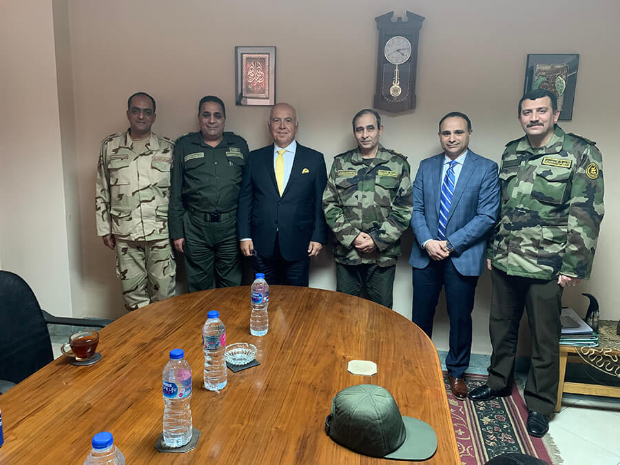 Members of the Egyptian military pose with ThinkRF executives as they sign a new contract